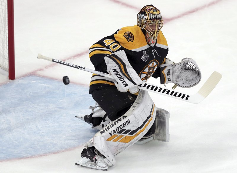 Boston Bruins goaltender Tuukka Rask, of Finland, turns the puck away during the first period in Game 1 of the NHL hockey Stanley Cup Final against the St. Louis Blues, Monday, May 27, 2019, in Boston. (AP Photo/Charles Krupa)
