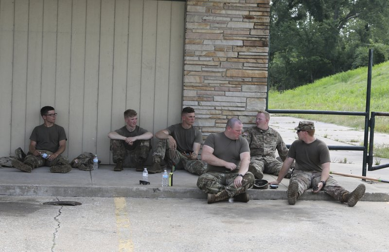 National Guardsman rest after working to fill sand behind a levee that was bubbling earlier today near West 67th and Charles page on Tuesday, May 28, 2019. (Tom Gilbert/Tulsa World/Tulsa World via AP)