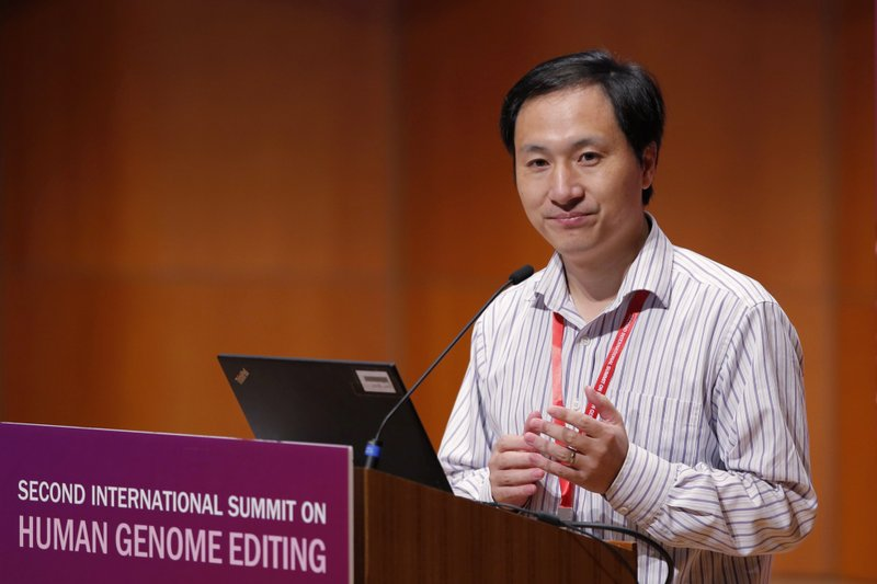FILE - In this Nov. 28, 2018, file photo, He Jiankui speaks during the Human Genome Editing Conference in Hong Kong. Six months after He was widely scorned for helping to make the world's first gene-edited babies, new information suggests that others may be interested in pursuing such work outside the United States. (AP Photo/Kin Cheung, File)