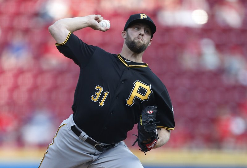 Pittsburgh Pirates starting pitcher Jordan Lyles (31) throws against the Cincinnati Reds during the first inning of a baseball game, Tuesday, May 28, 2019, in Cincinnati. (AP Photo/Gary Landers)