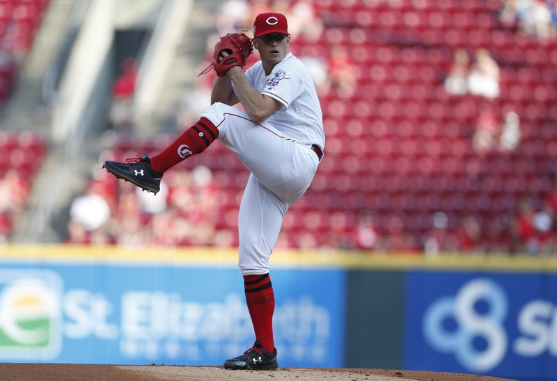 Cincinnati Reds starting pitcher Lucas Sims throws against the Pittsburgh Pirates during the first inning of a baseball game, Tuesday, May 28, 2019, in Cincinnati. (AP Photo/Gary Landers)