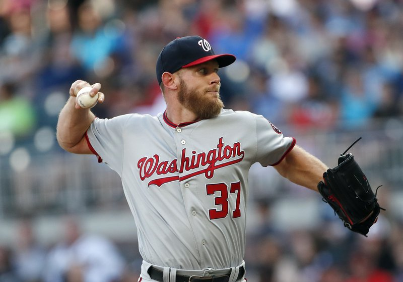 Washington Nationals starting pitcher Stephen Strasburg (37) works against the Atlanta Braves in the first inning of a baseball game, Tuesday, May 28, 2019, in Atlanta. (AP Photo/John Bazemore)