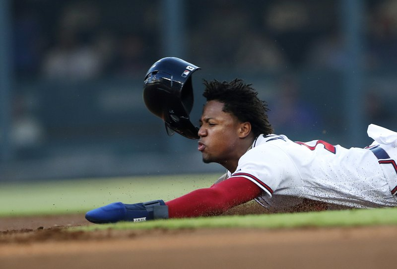 Atlanta Braves left fielder Ronald Acuna Jr. (13) slides head-first as he steals second base in the first inning of a baseball game against the Washington Nationals, Tuesday, May 28, 2019, in Atlanta. (AP Photo/John Bazemore)