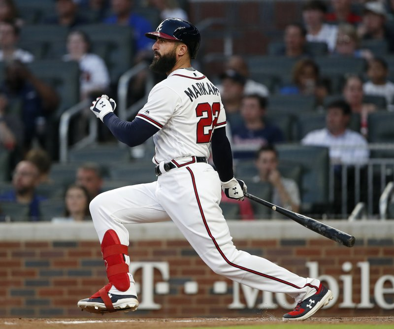 Atlanta Braves' Nick Markakis drives in a run with a base hit in the fourth inning of a baseball game against the Washington Nationals, Tuesday, May 28, 2019, in Atlanta. (AP Photo/John Bazemore)