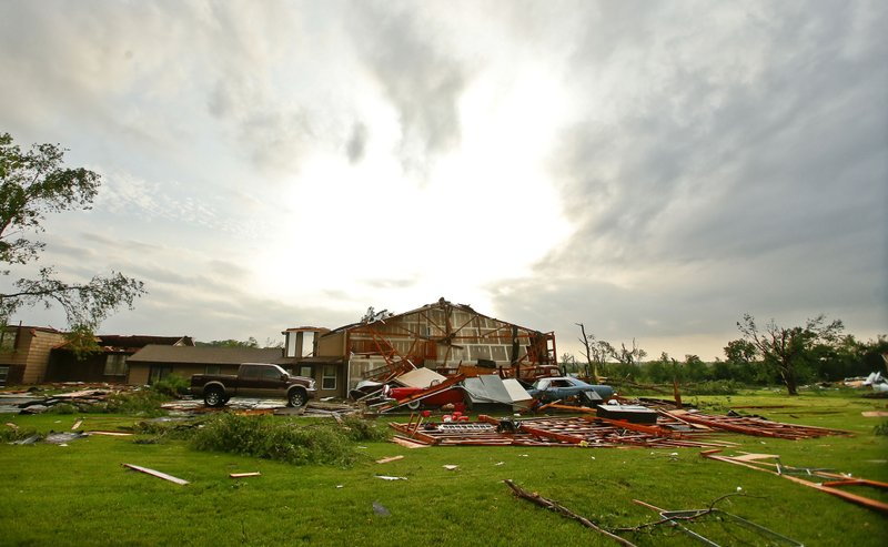 The sky begins to clear over a destroyed home after a tornado touched down in a neighborhood south of Lawrence, Kan., near US-59 highway and N. 1000 Road on Tuesday, May 28, 2019. The past couple of weeks have seen unusually high tornado activity in the U.S., with no immediate end to the pattern in sight. (Chris Neal/The Topeka Capital-Journal via AP)