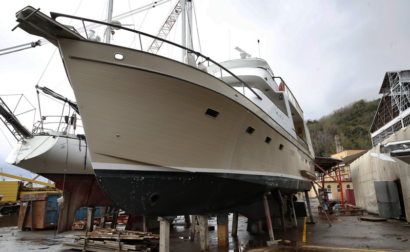 The impounded yacht Pasimafi V sits on wooden posts in Lerici, Italy, on Wednesday, April 3, 2019. Italian prosecutors allege Dr. Guido Fanelli bought the yacht with kickbacks he got from pharmaceutical executives to help push opioids. The Carabinieri police were listening when an alleged co-conspirator joked that Mundipharma managers had given Fanelli so much money, the company logo should be plastered on the stern. (AP Photo/Antonio Calanni)