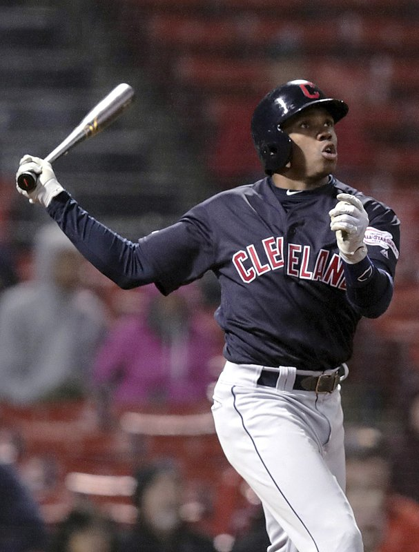 Cleveland Indians' Greg Allen watches the flight of his two-run home run off Boston Red Sox relief pitcher Ryan Brasier during the ninth inning of a baseball game at Fenway Park in Boston, Tuesday, May 28, 2019. (AP Photo/Charles Krupa)