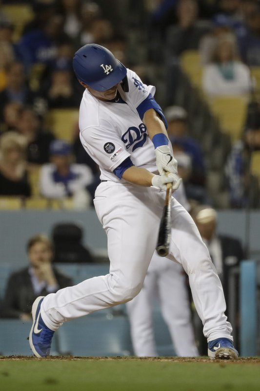 Los Angeles Dodgers' Will Smith hits a double against the New York Mets during the seventh inning of a baseball game in Los Angeles, Tuesday, May 28, 2019. (AP Photo/Chris Carlson)