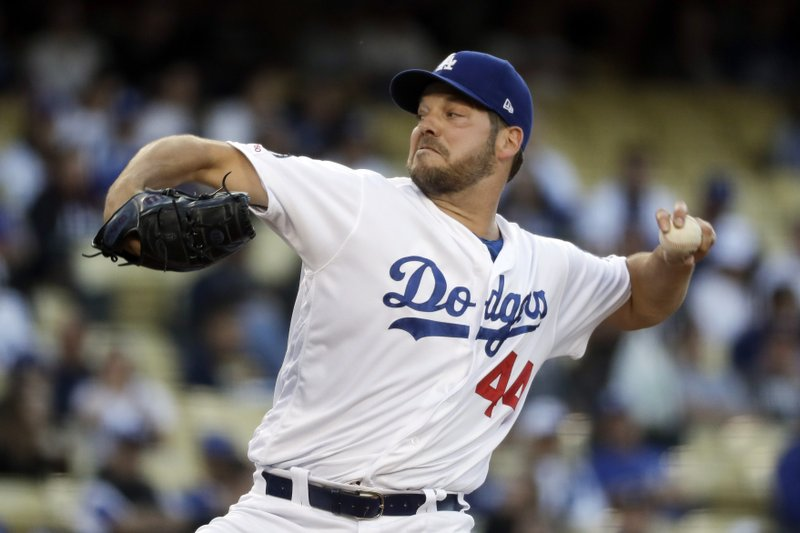 Los Angeles Dodgers starting pitcher Rich Hill throws against the New York Mets during the first inning of a baseball game in Los Angeles, Tuesday, May 28, 2019. (AP Photo/Chris Carlson)