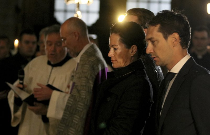 Birgit Lauda, 2nd right, widow of the formular Formula One driver Niki Lauda, attends a funeral service for Lauda in Vienna, Austria, Wednesday, May 29, 2019. Three-time Formula One world champion Niki Lauda, who won two of his titles after a horrific crash that left him with serious burns and went on to become a prominent figure in the aviation industry, has died on May 21, 2109. He was 70. (AP Photo/Ronald Zak)