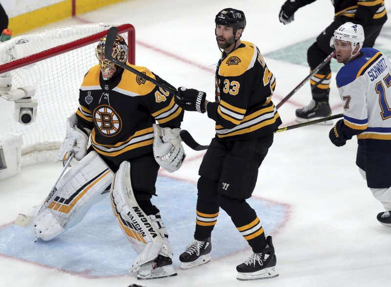 Boston Bruins goaltender Tuukka Rask (40), of Finland, and Zdeno Chara (33), of Slovakia, defend the net as St. Louis Blues' Jaden Schwartz, right, skates by during the third period in Game 1 of the NHL hockey Stanley Cup Final, Monday, May 27, 2019, in Boston. (Bruce Bennett/Pool via AP)