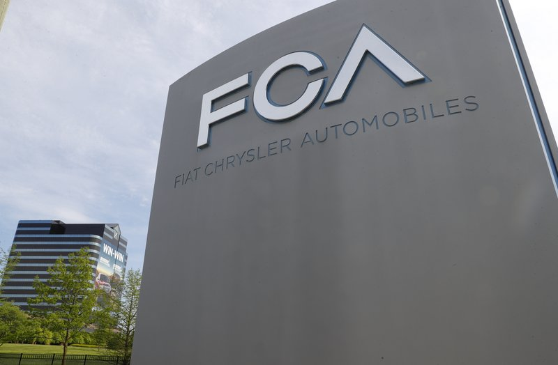 FILE - In this May 27, 2019, file photo, the Fiat Chrysler Automobiles world headquarters is shown in Auburn Hills, Mich.. Fiat Chrysler's proposal to merge with Renault was presented to Nissan on Wednesday, May 29, 2019, adding another big question to the list of uncertainties facing the Japanese automaker. (AP Photo/Paul Sancya, File)