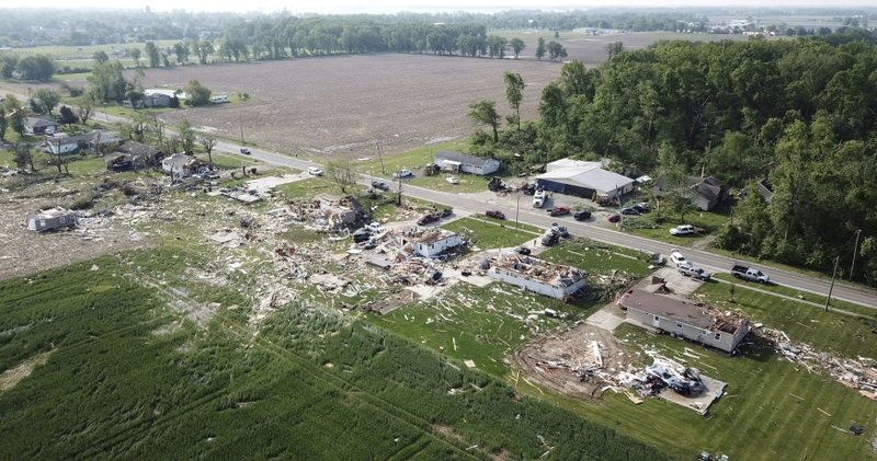In this Tuesday, May 28, 2019 aerial photo, damaged homes and debris mark the path of a tornado in Celina, Ohio. After Monday's tornadoes, Ohio Gov. Mike DeWine declared a state of emergency in the three counties with the most damage. (Ryan Snyder/Daily Standard via AP)