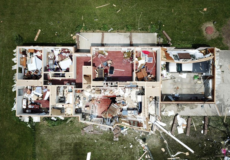 In this Tuesday, May 28, 2019 aerial photo, a home west of Celina, Ohio, has had its roof torn off by a tornado that was part of a storm system that passed through Monday night. After Monday's tornadoes, Ohio Gov. Mike DeWine declared a state of emergency in the three counties with the most damage. (Ryan Snyder/Daily Standard via AP)
