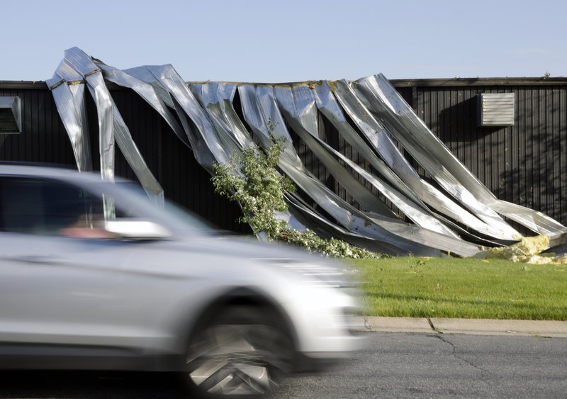 A person drives past a weather damaged business Wednesday, May 29, 2019 in Morgantown, Pa. The National Weather Service says a tornado has been confirmed Tuesday in eastern Pennsylvania, where damage to some homes and businesses occurred, but there were no immediate reports of injuries. (AP Photo/Jacqueline Larma)