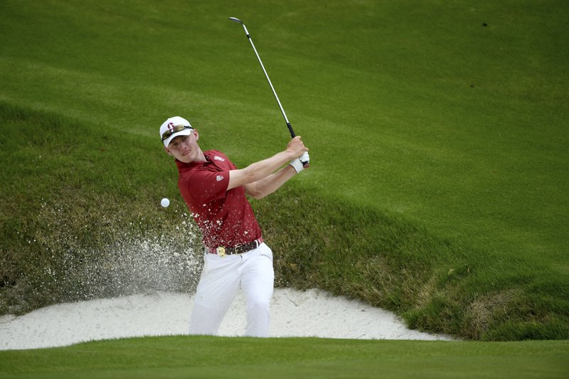 Stanford's David Snyder chips out of a bunker on the 12th hole during the final round against Texas in the NCAA men's college golf tournament Wednesday, May 29, 2019, in Fayetteville, Ark. (AP Photo/Michael Woods)