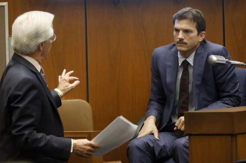 Defense Attorney Daniel Nardoni, left, questions Ashton Kutcher during his tesitimony in the murder trial of Michael Gargiulo at Los Angeles Superior Court, Wednesday, May 29, 2019. Gargiulo, 43, has pleaded not guilty to two counts of murder and an attempted-murder charge stemming from attacks in the Los Angeles area between 2001 and 2008, including the death of Kutcher's former girlfriend, 22-year-old Ashley Ellerin.  (Genaro Molina/Los Angeles Times via AP, Pool)