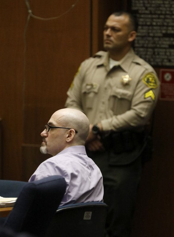 Michael Gargiulo, left, listens to the testimony of Austin Kutcher during Gargiulo's murder trial at Los Angeles Superior Court, Wednesday, May 29, 2019. Gargiulo, 43, has pleaded not guilty to two counts of murder and an attempted-murder charge stemming from attacks in the Los Angeles area between 2001 and 2008, including the death of Kutcher's former girlfriend, 22-year-old Ashley Ellerin.  (Genaro Molina/Los Angeles Times via AP, Pool)