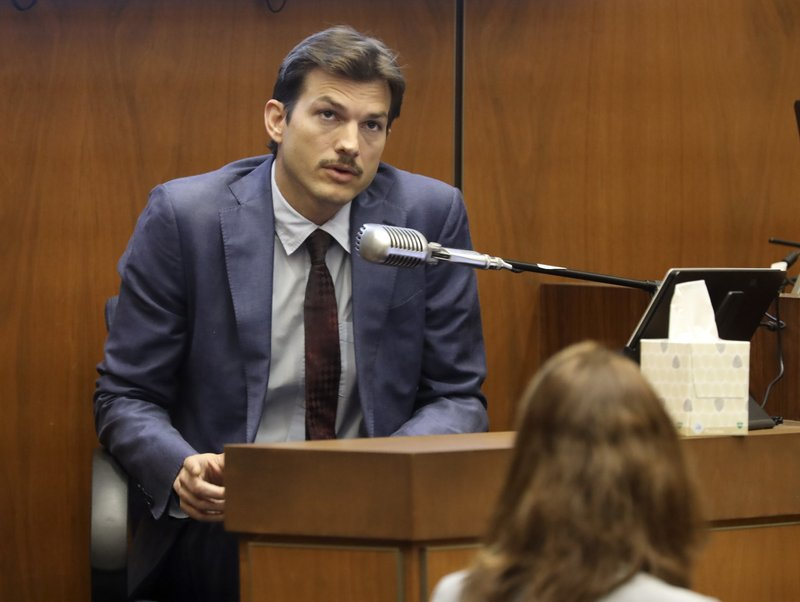Ashton Kutcher testifies in the murder trial of Michael Gargiulo at Los Angeles Superior Court, Wednesday, May 29, 2019. Gargiulo, 43, has pleaded not guilty to two counts of murder and an attempted-murder charge stemming from attacks in the Los Angeles area between 2001 and 2008, including the death of Kutcher's former girlfriend, 22-year-old Ashley Ellerin. (Frederick M. Brown/Pool via AP)