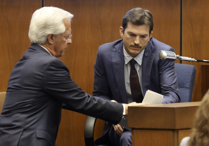 Defense Attorney Daniel Nardoni, left, questions Ashton Kutcher during his tesitimony in the murder trial of Michael Gargiulo at Los Angeles Superior Court, Wednesday, May 29, 2019. Gargiulo, 43, has pleaded not guilty to two counts of murder and an attempted-murder charge stemming from attacks in the Los Angeles area between 2001 and 2008, including the death of Kutcher's former girlfriend, 22-year-old Ashley Ellerin. (Frederick M. Brown/Pool via AP)