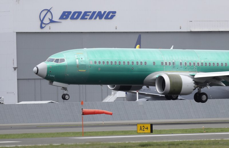 FILE - In this April 10, 2019, file photo, a Boeing 737 Max 8 airplane being built for India-based Jet Airways lands following a test flight at Boeing Field in Seattle. An Ethiopian pilot pleaded with his bosses for more training on the Boeing Max, just weeks before one of the airline's jets crashed, killing everyone on board. (AP Photo/Ted S. Warren, File)