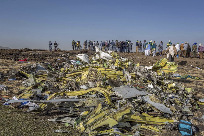 FILE - In this March 11, 2019, file photo, wreckage is piled at the crash scene of an Ethiopian Airlines flight crash near Bishoftu, Ethiopia.  Pilot Bernd Kai von Hoesslin pleaded with his bosses for more training on the Boeing Max, just weeks before the Ethiopian Airline's jet crashed, killing everyone on board. (AP Photo/Mulugeta Ayene, File)