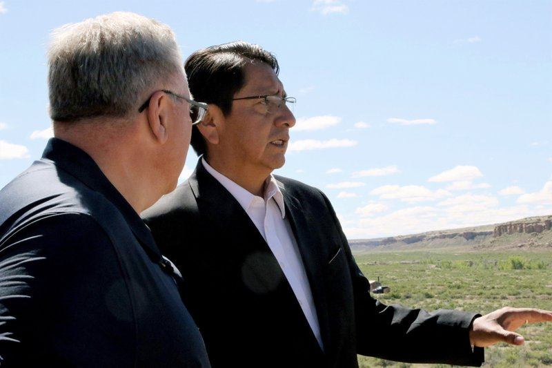 Navajo Nation President Jonathan Nez, right, and U.S. Interior Secretary David Bernhardt look out over Pueblo Bonito, at Chaco Culture National Historical Park, N.M., Tuesday, May 28, 2019. Bernhardt has met with tribal leaders who are supporting legislation to prevent drilling on land they consider sacred around Chaco Culture National Historical Park. Nez has previously said that many tribes want a greater area around Chaco protected from industrial incursions. (Hannah Grover/The Daily Times via AP)
