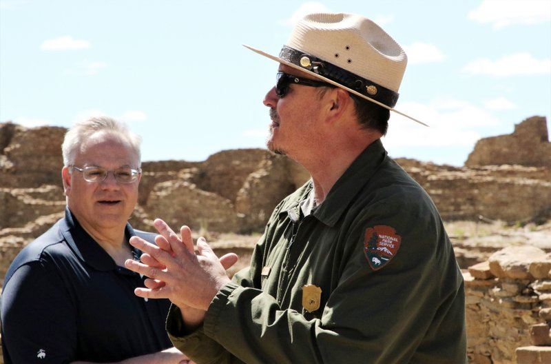 U.S. Interior Secretary David Bernhardt listens while Chaco Culture National Historical Park Chief of Interpretation Nathan Hatfield talks during a tour of Pueblo Bonito in San Juan County, N.M., Tuesday, May 28, 2019. Bernhardt has met with tribal leaders Tuesday who are supporting legislation to prevent drilling on land they consider sacred around Chaco Culture National Historical Park. (Hannah Grover/The Daily Times via AP)