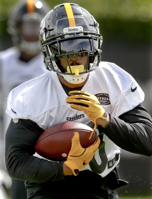 FILE - This May 21, 2019, file photo shows Pittsburgh Steelers running back Jaylen Samuels (38) performing drills during an NFL football practice in Pittsburgh. Teammate James Conner is now entrenched as the starter entering his third season, but welcomes the chance to share the load with Samuels and rookie Benny Snell Jr. (AP Photo/Keith Srakocic)