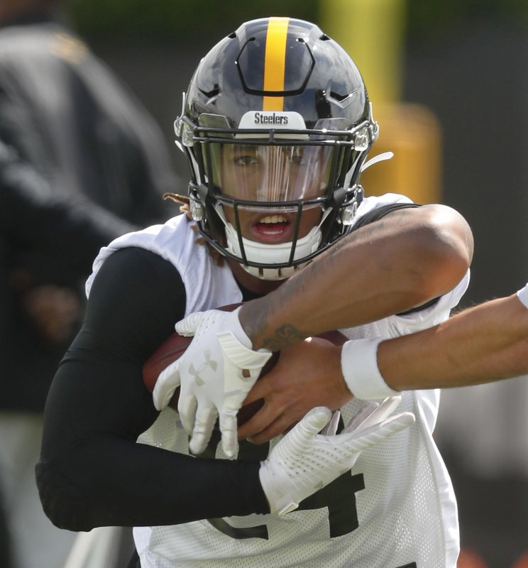 FILE - This May 21, 2019, file photo shows Pittsburgh Steelers rookie running back Benny Snell Jr. performing drills during an NFL football practice in Pittsburgh. Teammate James Conner is now entrenched as the starter entering his third season, but welcomes the chance to share the load with Jaylen Samuels and Snell. (AP Photo/Keith Srakocic, File)