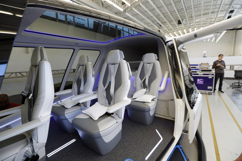 This Tuesday, May 28, 2019, photo shows the interior of The Skai vehicle, developed by Alaka'i Technologies in Newbury Park, Calif. A transportation company on Wednesday will unveil a 5-person flying vehicle powered by hydrogen fuel cells. (AP Photo/Marcio Jose Sanchez)