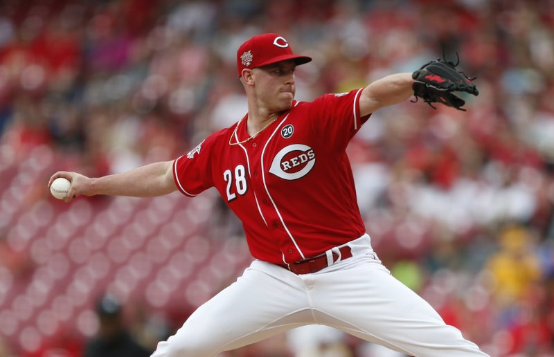 Cincinnati Reds starting pitcher Anthony DeSclafani (28) throws against the Pittsburgh Pirates during the first inning of a baseball game, Wednesday, May 29, 2019, in Cincinnati. (AP Photo/Gary Landers)