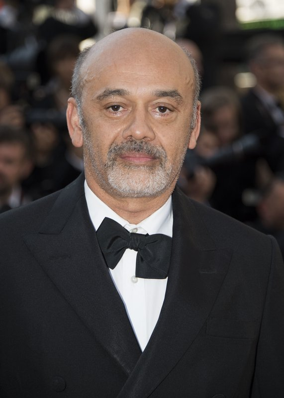 FILE - In this May 28, 2017 file photo Christian Louboutin attends the award ceremony at the 70th international Cannes Film festival in Cannes, France.  Louboutin and his famous towering, red-soled shoes are being awarded a prestigious fashion honor. The French designer will be the next honoree of the Couture Council of the Museum at the Fashion Institute of Technology. The annual award is given in early September, launching New York Fashion Week. (Photo by Arthur Mola/Invision/AP, File)