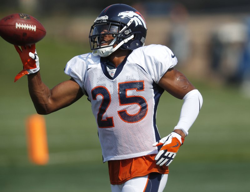 FILE - In this Tuesday, Aug. 7, 2019, file photograph, Denver Broncos defensive back Chris Harris takes part in drills during NFL football training camp in Englewood, Colo. The Broncos and Harris have ended their contract stalemate with the team bumping the cornerback's pay in 2019 from about $8 million to $12 million, which is $1 million more than the team's new cornerback, free agent Kareem Jackson is making. (AP Photo/David Zalubowski, File)