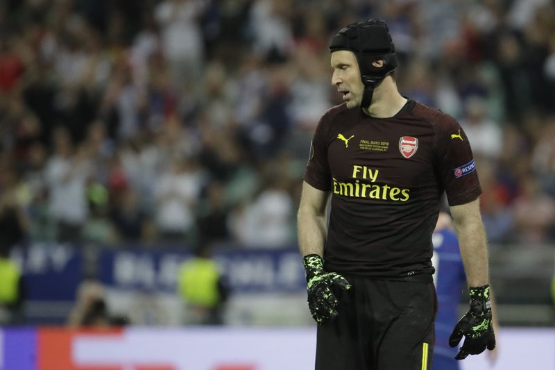 Arsenal goalkeeper Petr Cech reacts after Chelsea's Eden Hazard scores his side's third goal during the Europa League Final soccer match between Arsenal and Chelsea at the Olympic stadium in Baku, Azerbaijan, Wednesday, May 29, 2019. (AP Photo/Luca Bruno)
