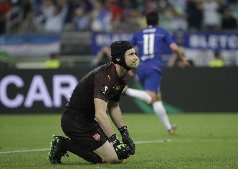 Arsenal goalkeeper Petr Cech gestures after Chelsea's Pedro Rodriguez, right, scores his side's second goal during the Europa League Final soccer match between Arsenal and Chelsea at the Olympic stadium in Baku, Azerbaijan, Wednesday, May 29, 2019. (AP Photo/Luca Bruno)