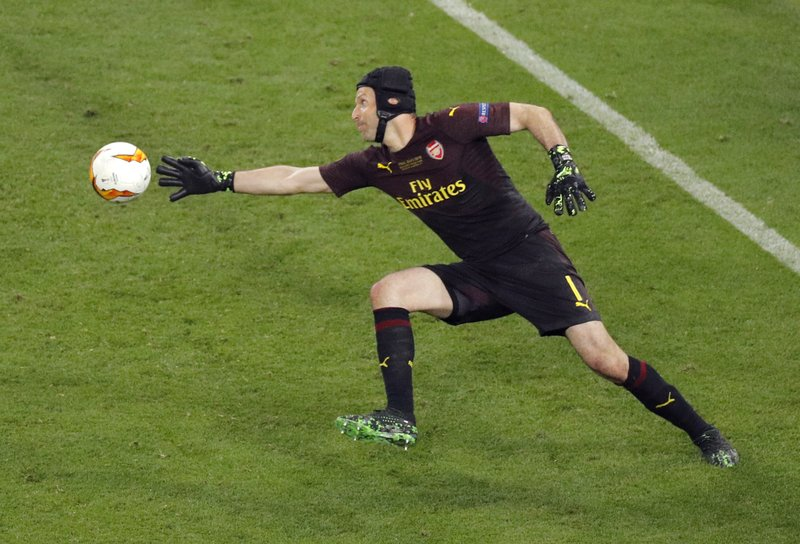 Arsenal goalkeeper Petr Cech defects the ball away from the net during the Europa League Final soccer match between Chelsea and Arsenal at the Olympic stadium in Baku, Azerbaijan, Wednesday, May 29, 2019. (AP Photo/Dmitri Lovetsky)