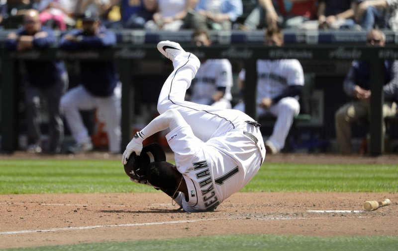 Seattle Mariners' Tim Beckham goes down after fouling a ball off his foot during the fifth inning of a baseball game against the Texas Rangers, Wednesday, May 29, 2019, in Seattle. The Rangers won 8-7. (AP Photo/Ted S. Warren)