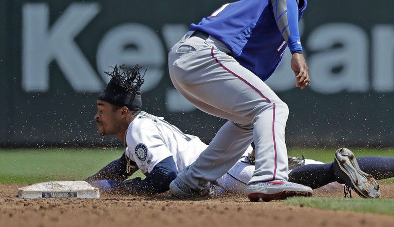 Seattle Mariners' Mallex Smith safely steals second base as Texas Rangers shortstop Elvis Andrus attempts the tag during the third inning of a baseball game, Wednesday, May 29, 2019, in Seattle. (AP Photo/Ted S. Warren)