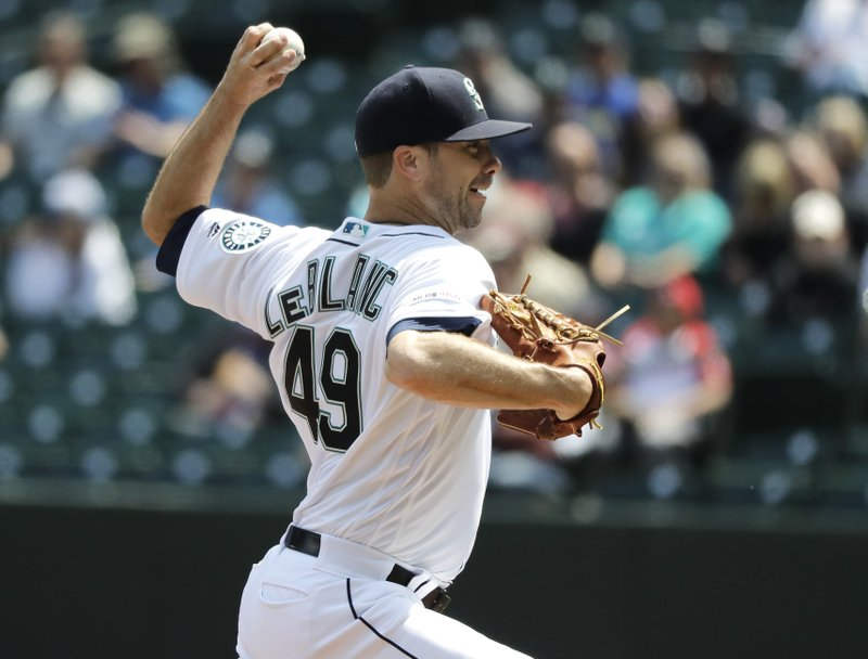 Seattle Mariners starting pitcher Wade LeBlanc throws against the Texas Rangers during the first inning of a baseball game, Wednesday, May 29, 2019, in Seattle. (AP Photo/Ted S. Warren)