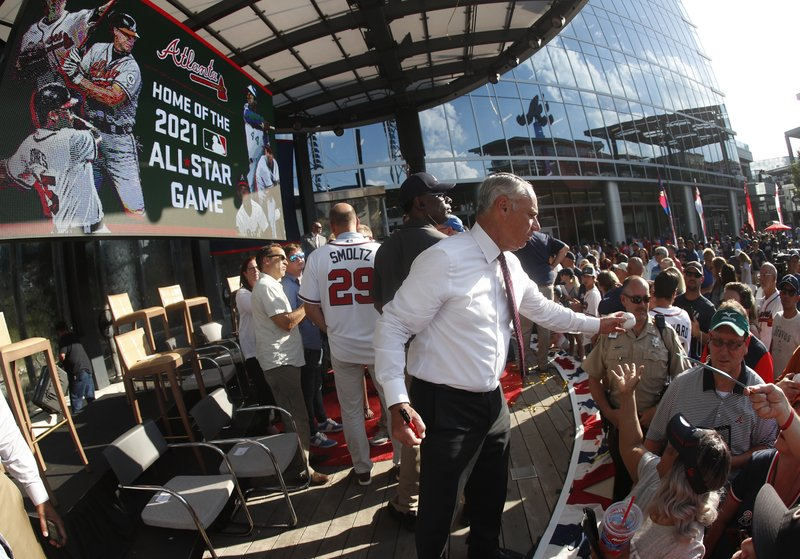 Baseball Commissioner Rob Manfred signs baseballs after announcing that Atlanta will host the 2021 All-Star Game, Wednesday, May 29, 2019, in Atlanta. (AP Photo/John Bazemore)
