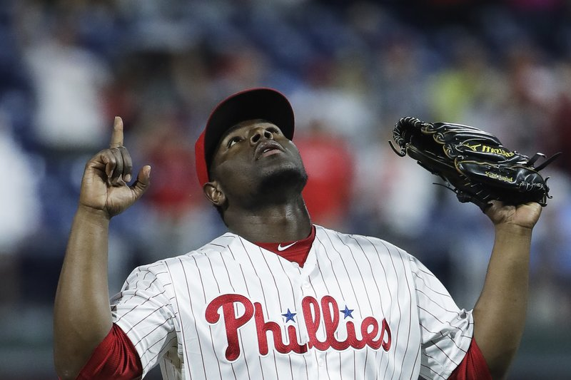 Philadelphia Phillies relief pitcher Hector Neris gestures after striking out St. Louis Cardinals' Kolten Wong during the ninths inning of a baseball game, Tuesday, May 28, 2019, in Philadelphia. The Phillies won 4-3. (AP Photo/Matt Rourke)