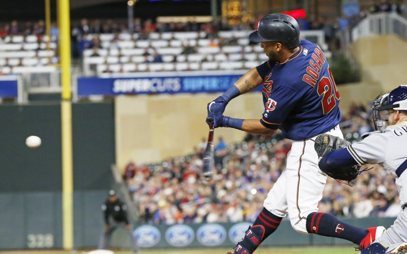 Minnesota Twins' Eddie Rosario hits a two-run home run off Milwaukee Brewers pitcher Junior Guerra in the seventh inning of a baseball game, Tuesday, May 28, 2019, in Minneapolis. The Twins won 5-3. (AP Photo/Jim Mone)