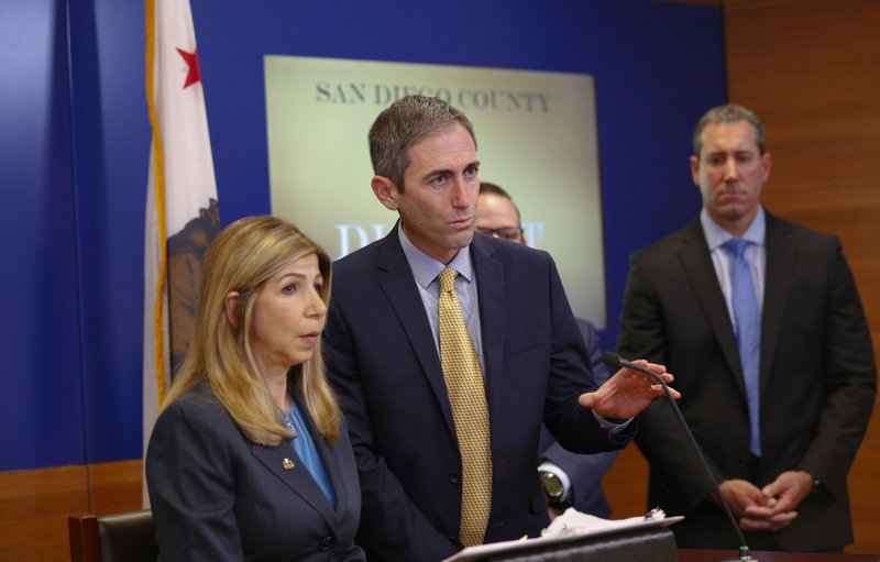 During a press conference Wednesday, May 29, 2019, San Diego District Attorney, Summer Stephan and Deputy District Attorney, Leon Schorr answered questions from news reporters on the investigation and case involving a statewide charter school scheme that allegedly stole more than $50 million in public funds. (Nelvin C. Cepeda /The San Diego Union-Tribune via AP)