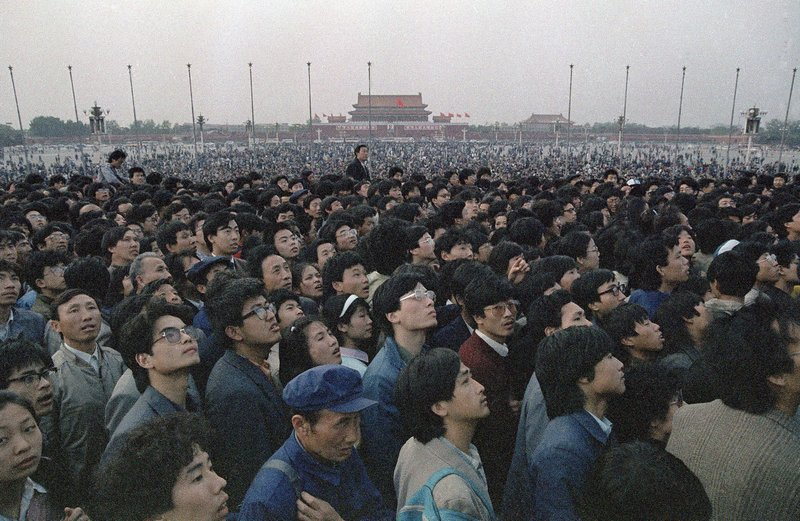 FILE - In this April 21, 1989 file photo, tens of thousands of students and citizens crowd at the Martyr's Monument at Beijing's Tiananmen Square. Over seven weeks in 1989, the student-led pro-democracy protests centered on Beijing's Tiananmen Square became China's greatest political upheaval since the end of the decade-long Cultural Revolution more than a decade earlier. Next week marks the 30th anniversary of the bloody crackdown that ended the protest. (AP Photo/Sadayuki Mikami, File)