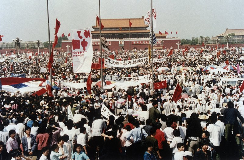 FILE - In this May 17, 1989, file photo, Tiananmen Square is filled with thousands during a pro-democracy rally, in Beijing, China. Over seven weeks in 1989, student-led pro-democracy protests centered on Beijing's Tiananmen Square became China's greatest political upheaval since the end of the Cultural Revolution more than a decade earlier.(AP Photo/Sadayuki Mikami, File)