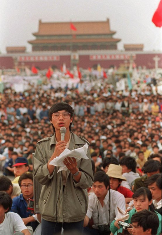 FILE - This May 27, 1989, file photo shows student leader Wang Dan in Tiananmen Square in Beijing, calling for a city wide march. Wang is urging Western nations to restore the link between human rights and trade with China during a press conference in Tokyo Wednesday, May 29, 2019, days ahead of the 30th anniversary of the 1989 student pro-democracy protests centered on Beijing's Tiananmen Square, of which he was a key leader. (AP Photo/Mark Avery, File)