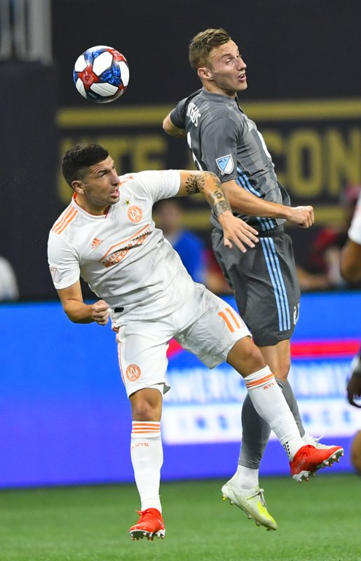 Atlanta United midfielder Eric Remedi (11) and Minnesota United midfielder Jan Gregus compete for a header during the first half of an MLS soccer match Wednesday, May 29, 2019, in Atlanta. (AP Photo/John Amis)