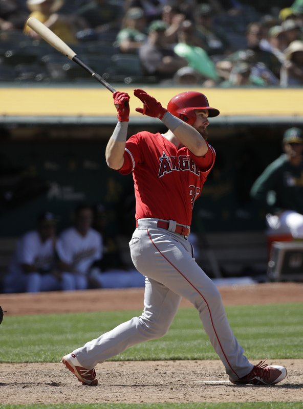 Los Angeles Angels' Jared Walsh follows through on an RBI single against the Oakland Athletics during the ninth inning of a baseball game in Oakland, Calif., Wednesday, May 29, 2019. (AP Photo/Jeff Chiu)
