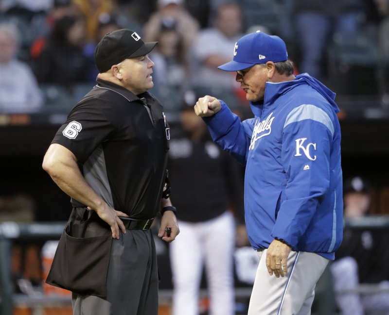 Kansas City Royals manager Ned Yost, right, makes his point to home plate umpire Mark Carlson after Carlson ejected starting pitcher Glenn Sparkman for hitting Chicago White Sox's Tim Anderson with a pitch during the second inning of a baseball game Wednesday, May 29, 2019, in Chicago. (AP Photo/Charles Rex Arbogast)